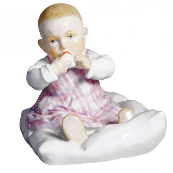 Kind auf Kissen 12,5 cm